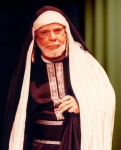 A older man, dressed in Bible garments, depicting the Pharisee, Nicodemus.